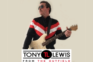 A photo of Tony Lewis From The Outfield playing guitar with a logo at the bottom.